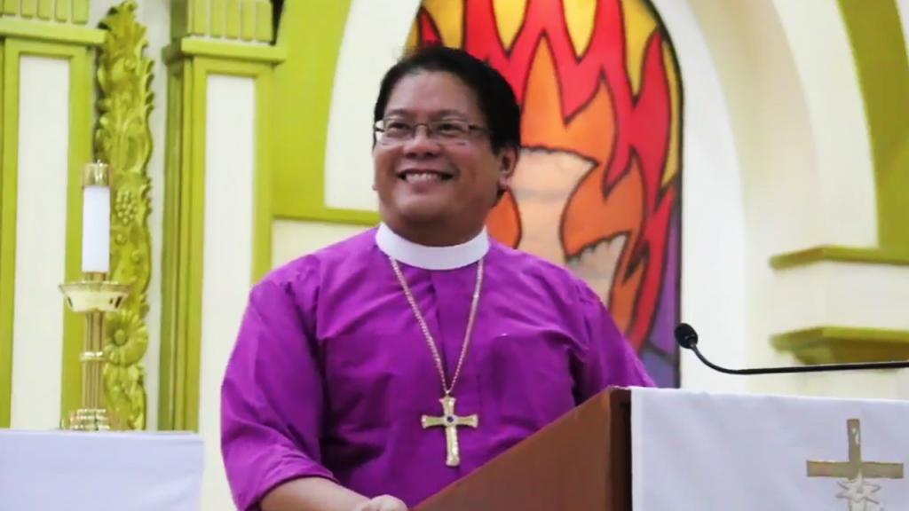 Bishop Ricardo preaching on a Wednesday fellowship